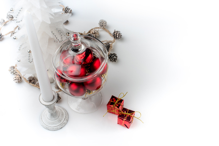 christmas decorations with white background: Christmas decorations and candle on white background