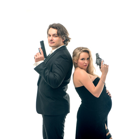 mr and mrs: Pregnant fashion woman and husband in gangsta style in mr and mrs Smith style