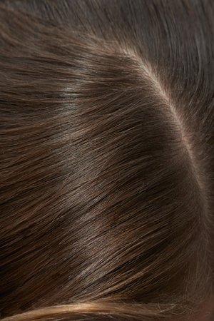 hair part: Straight part of hair fragment close up