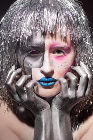 silver hair: Closeup of female face with bright makeup. beautiful woman with silver hair and hands