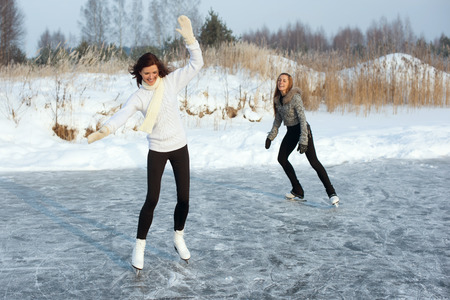 couching: young Figure skating women at the frozen lake in the winter