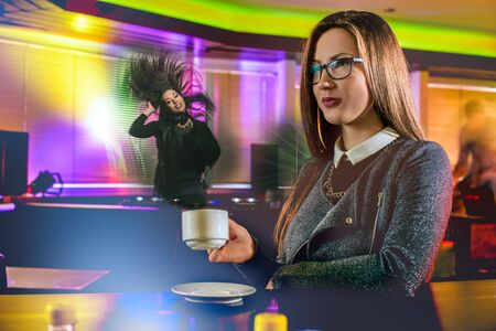 girls night: Young people having fun at night club. Confident girl drinking hot coffee