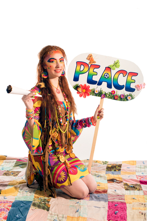bong: Young pretty hippie girl with peace poster and bong Stock Photo