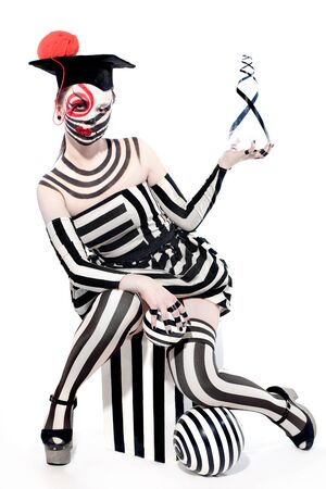 masquerade costumes: mysterious circus clown in Masquerade costume with creative make up