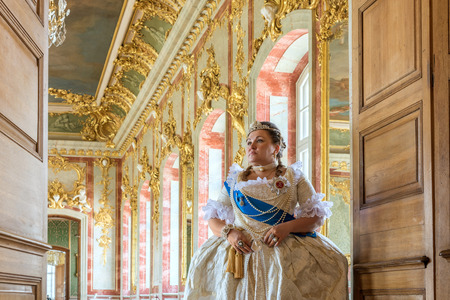 sceptre: Historical cosplay. Beautiful woman in the similitude of Catherine the Great, empress of Russia ancient dress in the palace