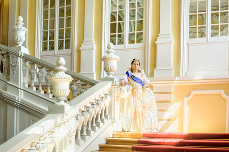 similitude: Historical cosplay. Beautiful woman in the similitude of Catherine the Great, empress of Russia ancient dress in the palace