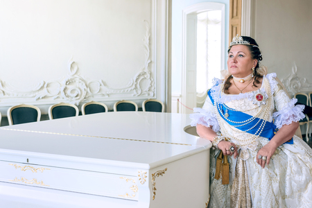 empress: Historical cosplay. Beautiful woman in the similitude of Catherine the Great, empress of Russia ancient dress in the palace