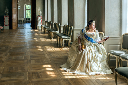 queen's theatre: Historical cosplay. Beautiful woman in the similitude of Catherine the Great, empress of Russia ancient dress in the palace