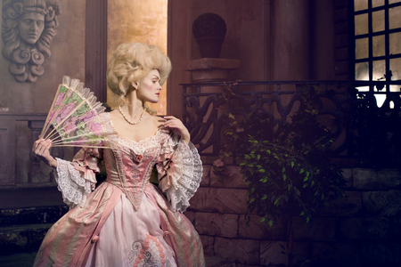 century plant: Victorian lady. Young woman in eighteenth century image posing in vintage exterior Stock Photo