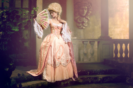 eighteenth: Victorian lady. Young woman in eighteenth century image posing in vintage exterior Stock Photo