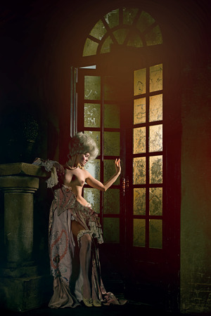 century plant: Half-naked Victorian lady. Young woman in eighteenth century image posing in vintage interior