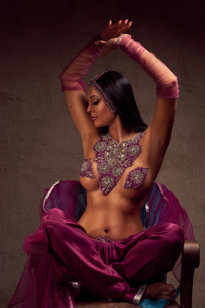 purdah: Eastern beautiful brunette woman in afghani pants, purdah and adornment.