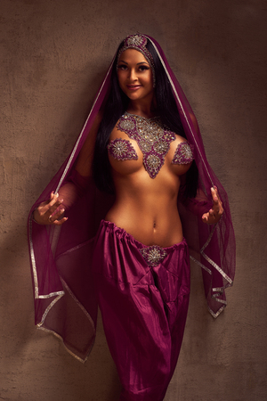 vedic: Eastern beautiful brunette  belly-dancer woman in afghani pants, purdah and adornment. Stock Photo