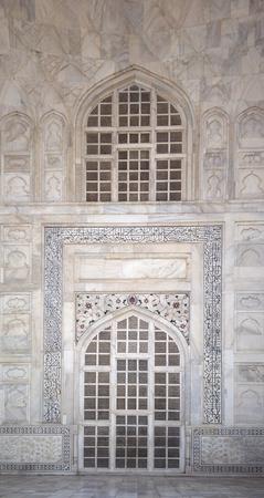 writ: Details of Taj Mahal architecture at the entrance on white marble background, Agra, Uttar Pradesh state, India