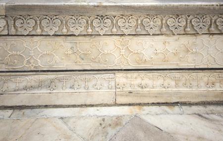 writ: Details of Taj Mahal architecture on white marble background, Agra, Uttar Pradesh state, India