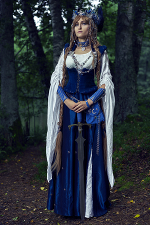 Valkyrie warrioress in magpie costume. Styling for the Scandinavian womens costume of the Viking Age. Stock Photo