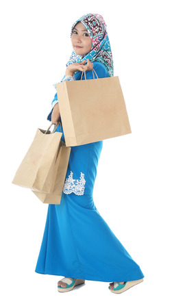 beautiful young muslimah woman with many shopping bags  photo