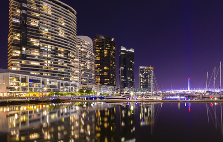 docklands: Modern apartments and a spectacular marina in Docklands in Melbourne, Australia at night Stock Photo