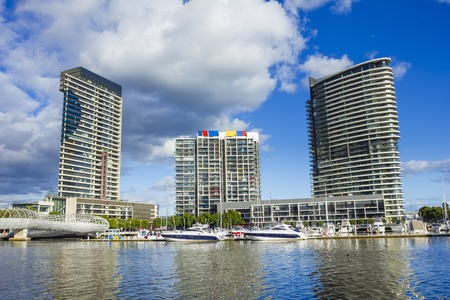 webb: Modern apartments, marina and Webb Bridge, Docklands in Melbourne, Australia during daytime