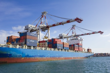 dockside: Melbourne, Australia - July 25, 2015: Containers to be unloaded in a container ship berthed at Swanson Dock in the Port of Melbourne that handles more than one third of Australias container trade.