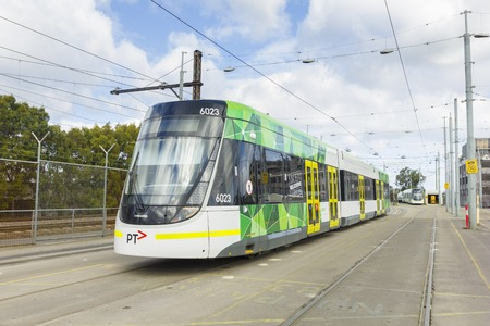 introduced: Melbourne, Australia - July 26, 2015: A E-Class tram in a city depot waiting to depart in Melbourne. This three section articulated low-floor tram was introduced in Melbourne in 2013.