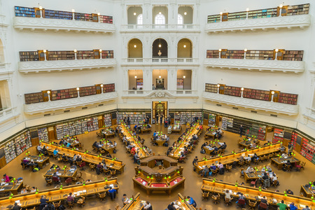 student library: Melbourne, Australia - August 1, 2015: Interior of La Trobe Reading Room of the State Library of Victoria in Melbourne. The library holds over 2 million books and 16,000 serials.