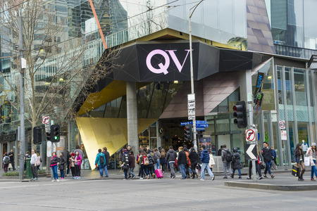precinct: Melbourne, Australia - August 1, 2015: Communters crossing the street outside QV, Queen Victoria Village at the heart of  Melbourne City. QV is a well established shopping and entertainment precinct.