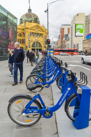 programme: Melbourne, Australia - August 8, 2015: Bikes from the Melbourne Bike Share programme parking at Federation Square, Melbourne for people to share and travel within the city. Editorial