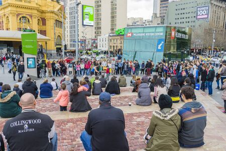 entertaining: Melbourne, Australia - August 8, 2015: Street performer entertaining the crowd at Federation Square in Melbourne. Editorial