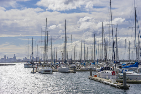motorboats: View of yachts or motorboats in floating marina with Melbournes skyline in the distance