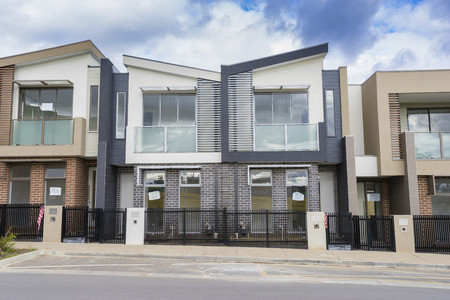 Melbourne, Australia - August 12, 2015: Newly built contemporary townhouses in Melbourne during daytime. Editöryel