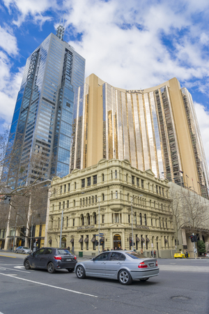 vuitton: Melbourne, Australia - August 16, 2015: Grand Hyatt Hotel, Louis Vuitton store and modern building in Melbournes CBD during daytime.