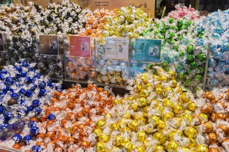 lindt: Melbourne, Australia - August 8, 2015: Closeup of the assortment of the iconic Lindt Lindor balls in Lindt Chocolate cafe in Melbourne. Editorial