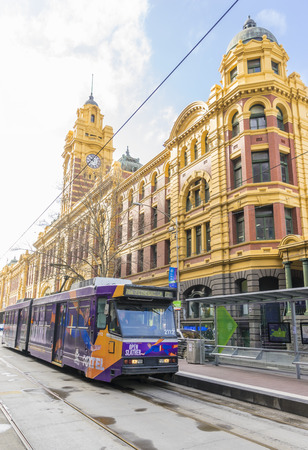 flinders: Melbourne, Australia - August 30, 2015: View of a tram outside the Flinders Street Station in Melbourne.