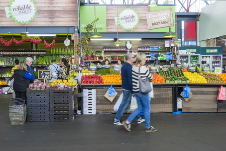 Melbourne, Australia - September 12, 2015: People doing grocery shopping in a market in Melbourne during daytime. Stock Photo - 45996128