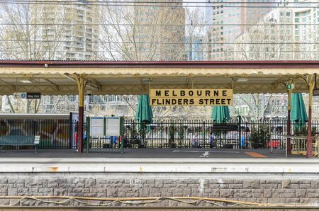 flinders: Melbourne, Australia - September 12, 2015: View of the platform of Flinders Street Railway Station in Melbourne during the daytime. Editorial