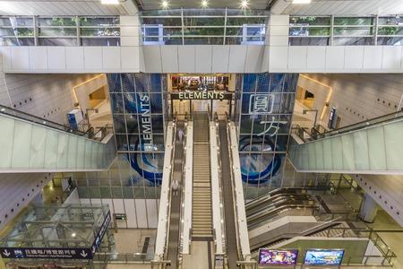hong kong: Hong Kong, China - June 16, 2015: View of interior of railway station connected to the Elements shopping mall in West Kowloon, Hong Kong.