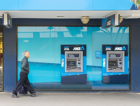 Melbourne, Australia - September 4, 2015: View of elderly man walking pass the ANZ bank in Melbourne. ANZ bank is one of the four largest banks in Australia.