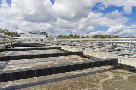 aeration: Aeration tank with waste water in a sewage treatment plant during daytime Stock Photo