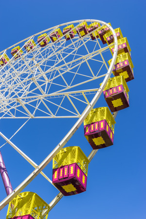 ferriswheel: Ferris wheel on the background of blue sky during daytime
