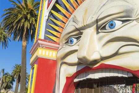 LUNA: Melbourne, Australia - September 10, 2015: Close-up of the entrance of Luna Park, that is a historic, landmark amusement park, in St Kilda, Melbourne. Editorial