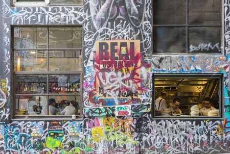 one lane: Melbourne, Australia - September 18, 2015:  View of customers and chefs in a restaurant in Hosier Lane, Melbourne. Hosier Lane is one of the citys best street art locations.