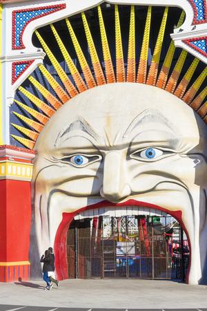 st kilda: Melbourne, Australia - September 10, 2015: View of the entrance of Luna Park, that is a historic, landmark amusement park, in St Kilda, Melbourne.