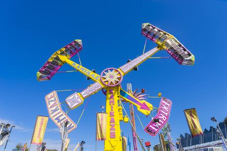 precinct: Melbourne, Australia - September 25, 2015: Pendulum amusement ride in the carnival precinct of the 2015 Royal Melbourne Show.