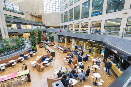 complex: Melbourne, Australia - September 18, 2015: Office workers in the modern food court in Collins Place, a shopping and office complex, in the heart of Melbournes CBD. Editorial