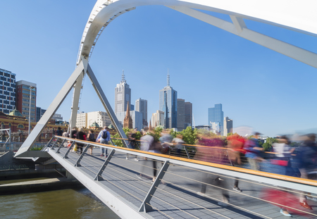 southgate: View of people in motion blur walking across the Southgate footbridge in Melbourne during daytime Stock Photo