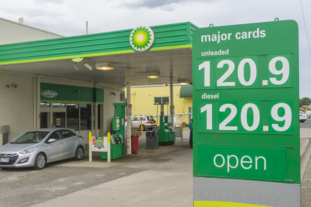 bp: Allansford, Australia - November 25, 2015: Close-up of petrol price sign with car leaving the BP service station in Allansford, Victoria. There are around 1400 BP service stations in Australia. Editorial