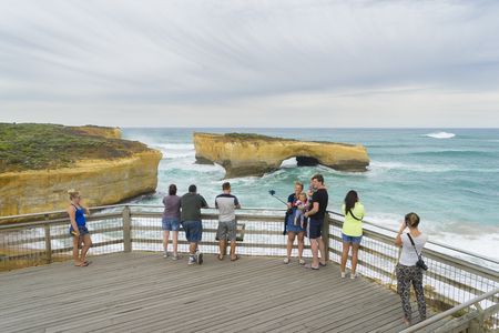 Victoria, Australia - November 25, 2015: Tourists taking photos   in London Arch, one of the popular spots along the Great Ocean Road, during daytime. Editorial