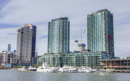 Melbourne, Australia - July 25, 2015: Modern waterfront apartments and yachts in marina in Docklands, Melbourne during daytime.
