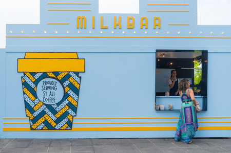 Melbourne, Australia - March 5, 2016: Woman and barista in the Milkbar in the Melbourne Food and Wine Festival. The festival is to promote the produce and food culture of Melbourne and Victoria.